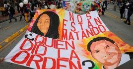 En la imagen, aparecen manifestantes durante una jornada de protesta nacional el 21 de octubre de 2020 en Bogotá.