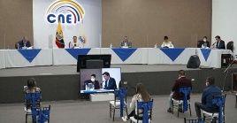 El Pleno del CNE ecuatoriano comunica la votación sobre el informe que pide el reconteo de votos.