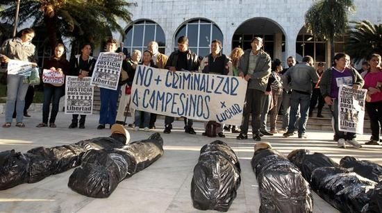 Activists protest outside Paraguay's Palace of Justice demanding impartiality for the Curuguaty massacre case.