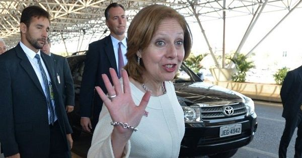 U.S. Ambassador to Brazil Liliana Ayalde waves at the Brasilia International airport, upon her arrival, Sept. 16, 2013.