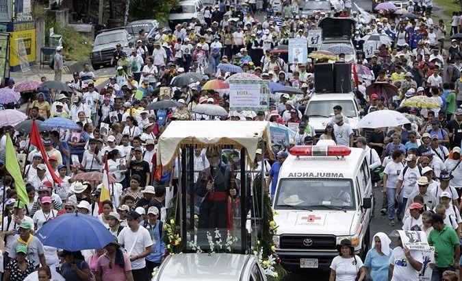 Pilgrims march to a Mass in Romero's honor in El Salvador