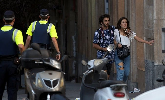 People run from the scene of the attack in Barcelona