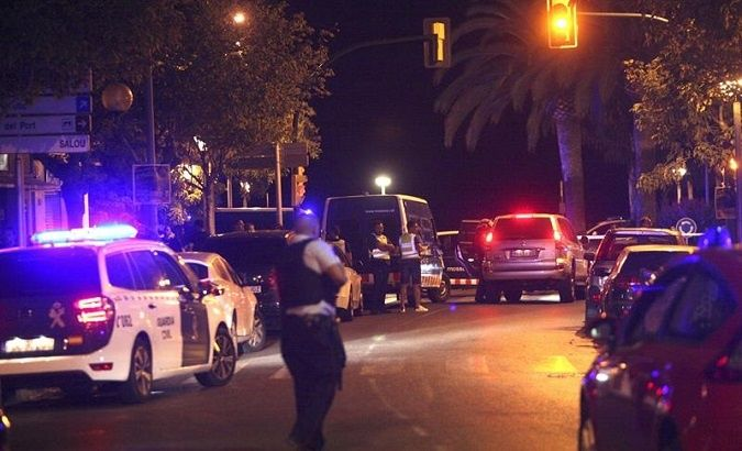 Police seal off the scene of the Cambrils attack