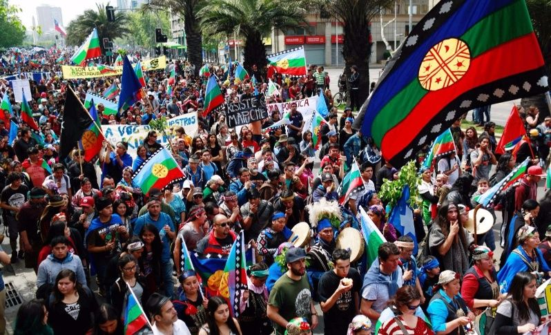 Mapuche Indian and other activists take part in a rally against Columbus Day in downtown Santiago, Chile October 9, 2017.